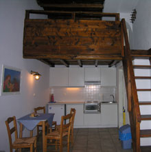 kitchen and wooden loft